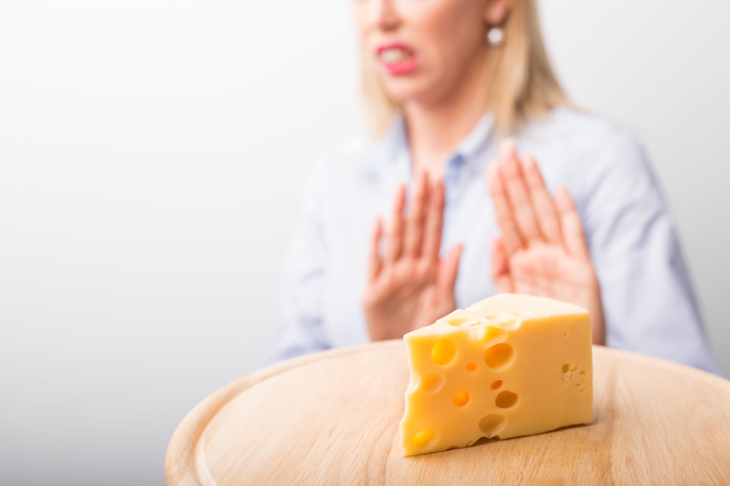 woman saying no to cheese
