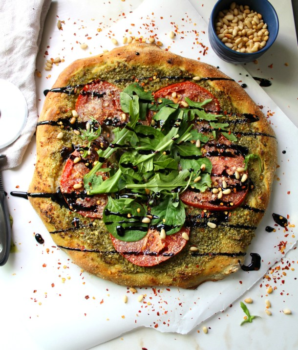 vegan pesto pizza with balsamic glaze