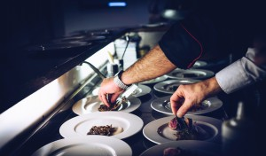 professional chefs preparing entrees in a restaurant kitchen
