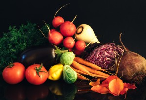 fresh fruits and vegetables against a black background